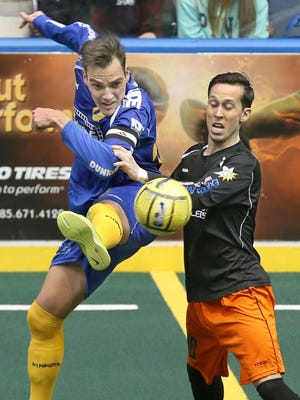 Lancers forward Mauricio Salles uses the back of his leg to fire a shot past Syracuse's Nate Boudreau during their MASL Eastern Division semifinal March 5 at Blue Cross Arena.