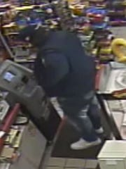 Police are trying to identify this man who they say stole a debit card from a man's car and used it.