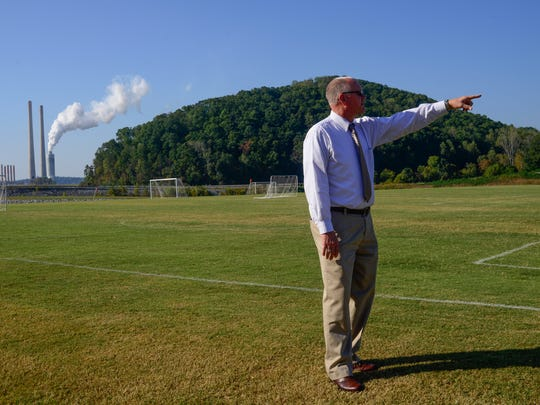 Roane County Executive Ron Woody points out features of the new Swan Pond Sports Complex Wednesday, Oct. 5, 2016, in Harriman. TVA helped the county create the facility as part of its remediation efforts in response to the coal ash spill. In the background is the TVA Kingston Fossil Plant. (PAUL EFIRD/NEWS SENTINEL)