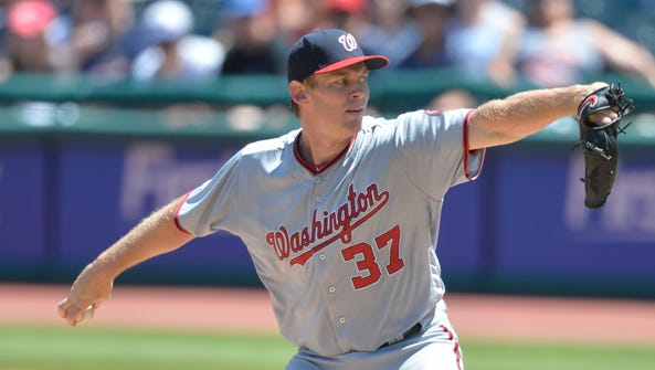 Stephen Strasburg leads the NL with 14 wins.