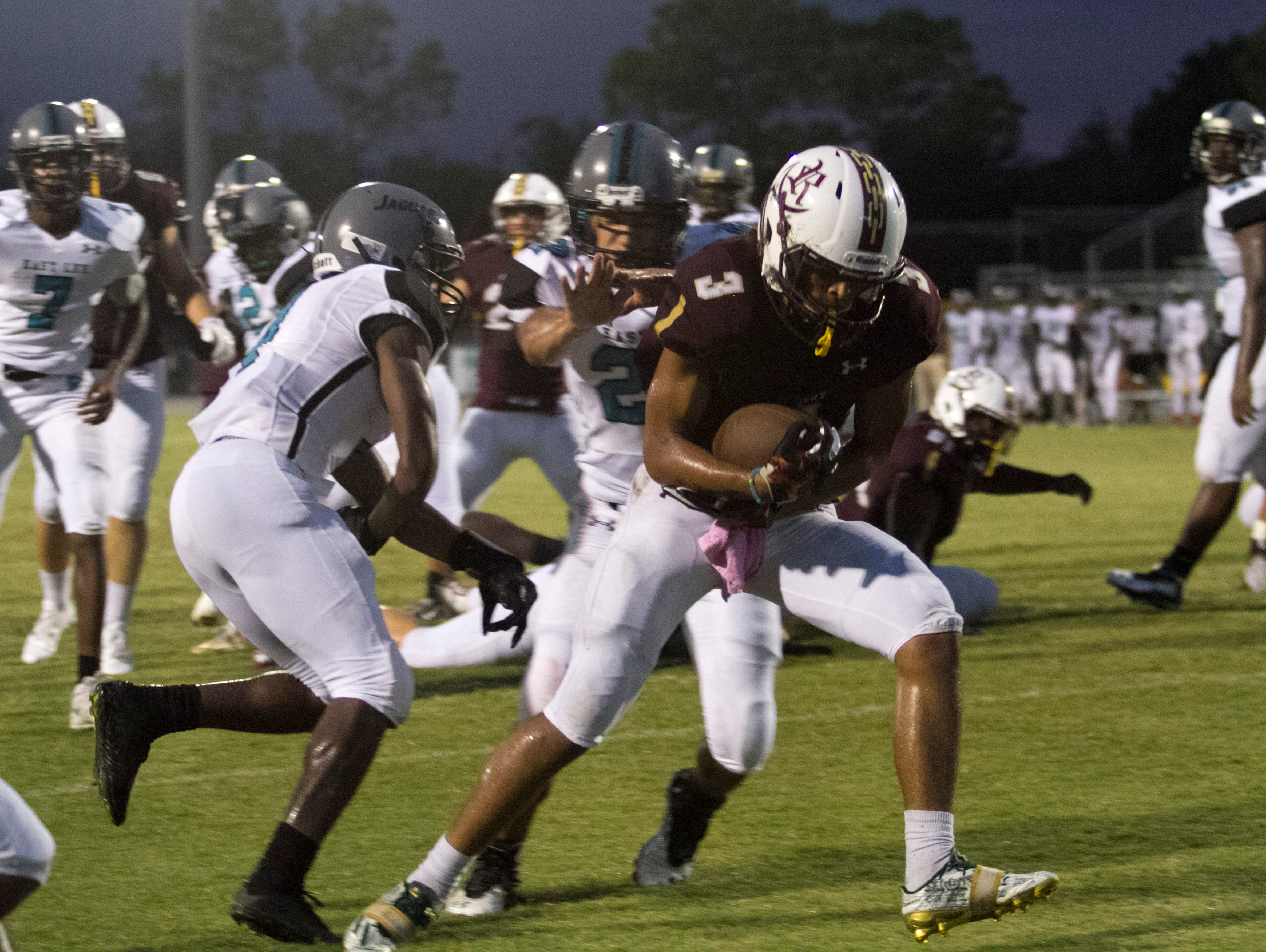 Riverdale's Jaylin Cochran scores the first touchdown against East Lee on Friday, September 16, 2016, at Riverdale High School.