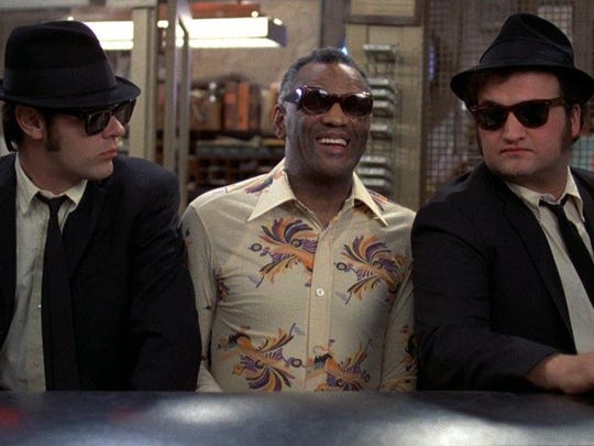 "They're on a mission from God: Dan Aykroyd (left) and John Belushi join Ray Charles in ""The Blues Brothers,"" which screens Oct. 20 at the Levitt Shell."