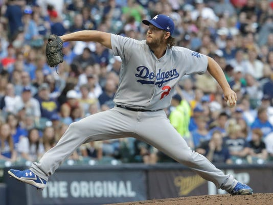 Los Angeles Dodgers starting pitcher Clayton Kershaw throws during the first inning of a baseball game against the Milwaukee Brewers Friday, June 2, 2017, in Milwaukee. (AP Photo/Morry Gash)