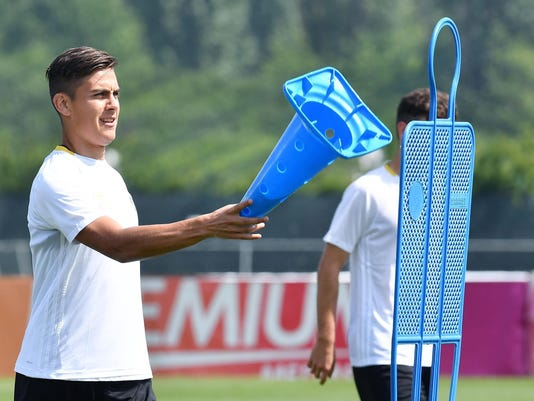 Juventus' Paulo Dybala attends a training session ahead of Wednesday's Champions League, quarterfinal second-leg soccer match against Barcelona, at the Vinovo sport center, near Turin, Italy, Tuesday, April 18, 2017. (Alessandro Di Marco/ANSA via AP)