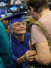 San Angelo resident Betty Jo Griffin, 90, greets a woman after accepting an honorary high school diploma from San Angelo ISD's Lake View High School Monday, May 14, 2018.