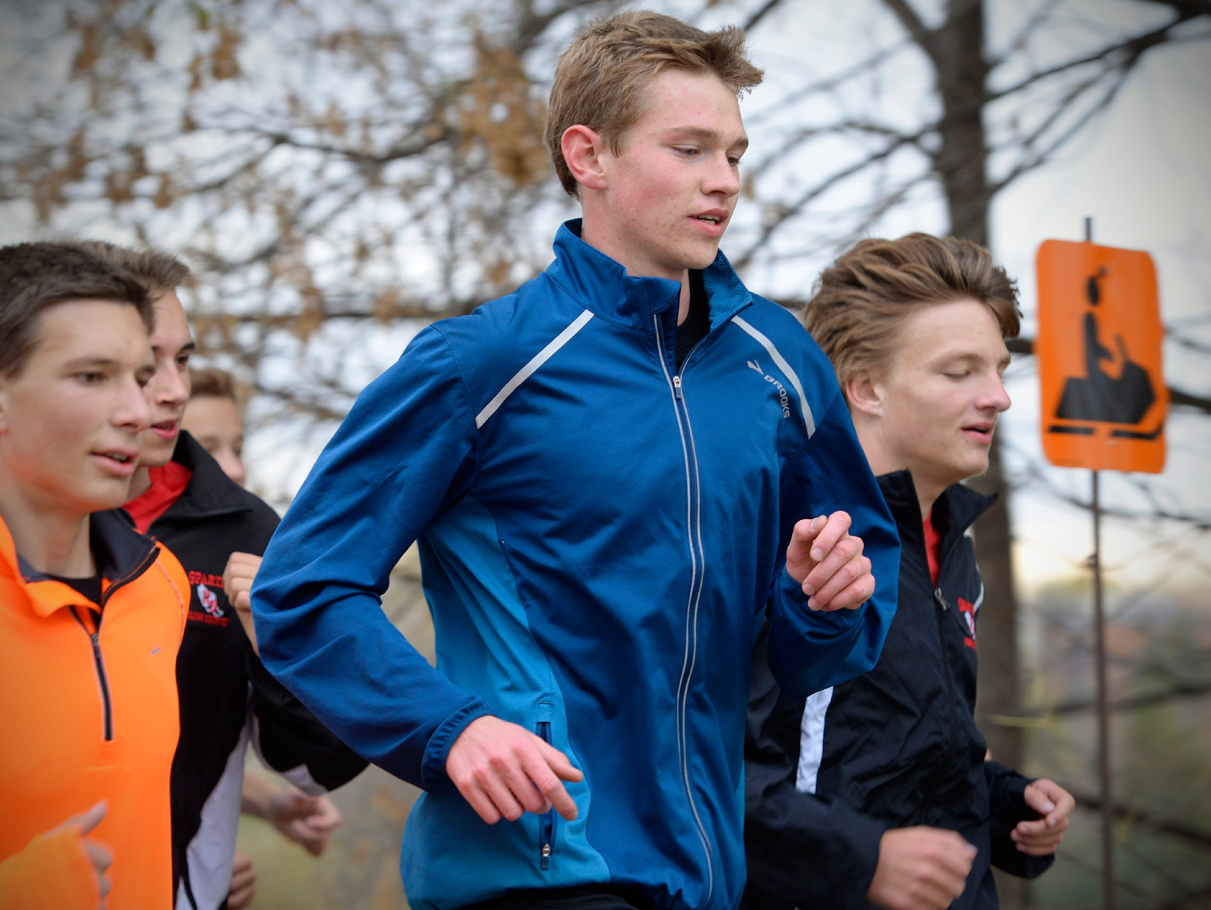 Rocori High School cross country runners Noah Lahr, center, and Will Glisky, right, and their teammates run through Cold Spring on Tuesday, Oct. 27. The Times named both Lahr and Glisky to its 2015 All-Area Boys Cross Country Team.