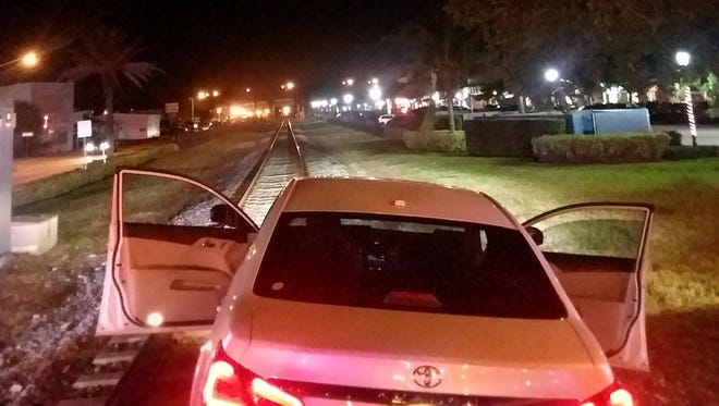 Arnold Marks' car sits on the train track in downtown Stuart a few hundred yards before a train was supposed to drive through Saturday night, April 14, 2018.