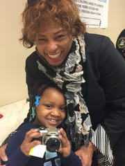 Congresswoman Brenda Lawrence with a homeless child