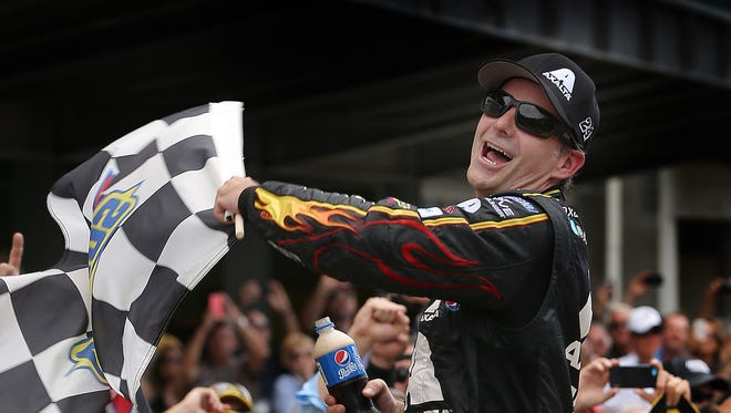Jeff Gordon celebrates winning Sunday's Brickyard 400 at the Indianapolis Motor Speedway.