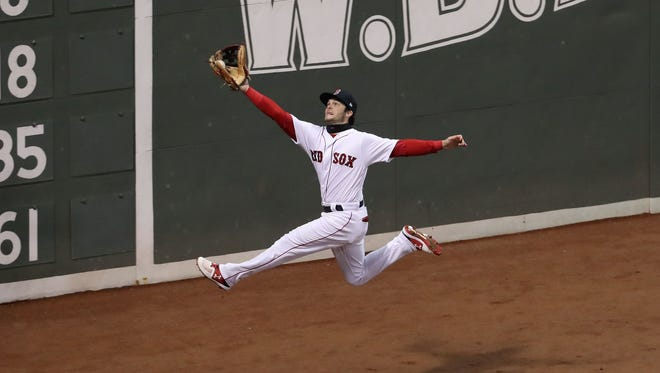 Boston Red Sox left fielder Andrew Benintendi catches a ball hit by Los Angeles Dodgers second baseman Brian Dozier during the fifth inning in game two of the 2018 World Series at Fenway Park in Boston.