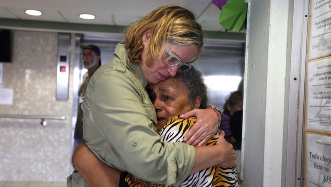 San Juan's Mayor Carmen Yulin Cruz hugs a woman during her visit to an elderly home in San Juan, Puerto Rico, Sept.  22, 2017.