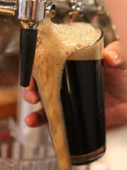 A Sin City Stout is poured at Argilla Brewing Co. at Pietro's Pizza in Milltown.