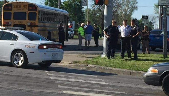 Police and school officials gather at Madison Avenue and Thompson Road, where a school bus struck and killed a pedestrian on Tuesday.