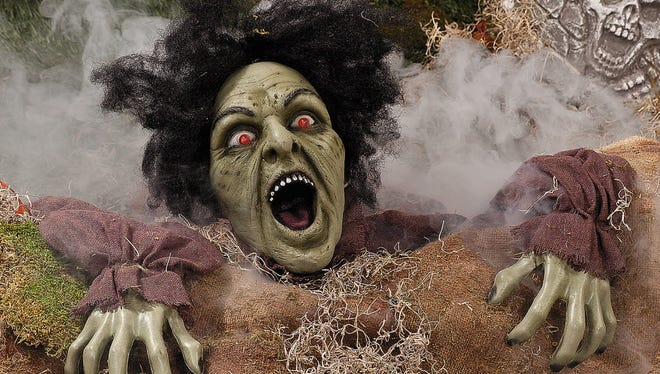 Outdoor decor creates spirited fun. Clawing zombie groundbreaker with LED light-up eyes, $28.50 at orientaltrading.com.