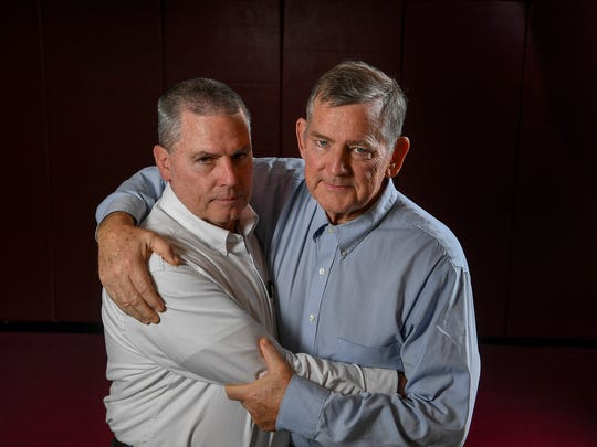 """I love him, I want to beat him, but we're still brothers when it's over,"" Father Ryan wrestling coach Patrick Simpson says of MBA wrestling coach Frank Simpson."