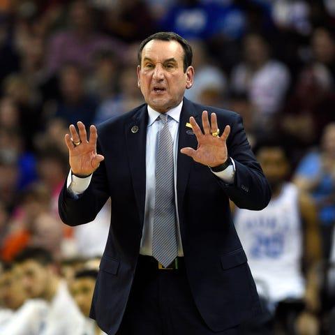 Duke coach Mike Krzyzewski gestures to his teams...