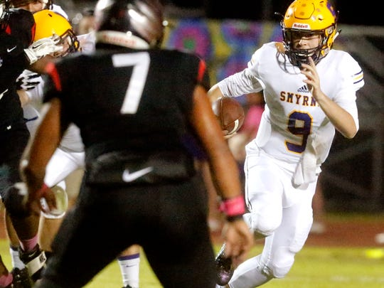 Smyrna's quarterback Alex Bannister (9) runs the ball during the game against Stewarts Creek, on Friday, Oct. 13, 2017, at Stewarts Creek.