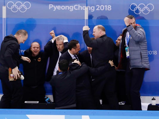 FILE - In this Feb. 21, 2018, file photo, the coaching staff of Germany with Marco Sturm, center, celebrate after a video review determined that Patrick Reimer, of Germany, scored a goal during the overtime period of the quarterfinal round of the men's hockey game against Sweden at the 2018 Winter Olympics in Gangneung, South Korea. Six years removed from his last NHL game, Marco Sturm has immersed himself in coaching and has underdog Germany in the Olympic semifinals against all odds. (AP Photo/Frank Franklin II, File)