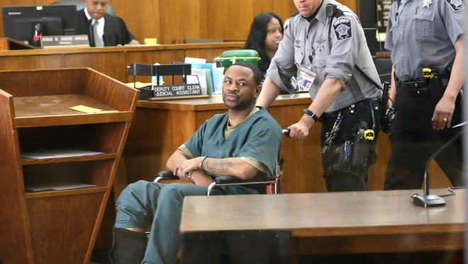 Antonio Smith, shown being wheeled into court, withdrew his plea and wants a different lawyer, instead of being sentenced on two murders and a plot to kill a third person.