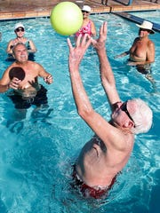 Winter visitor Elmer Kooi, 77, of Iowa, sets the ball during a volleyball game at Orangewood Shadows RV resort in Mesa on Jan. 9, 2015.