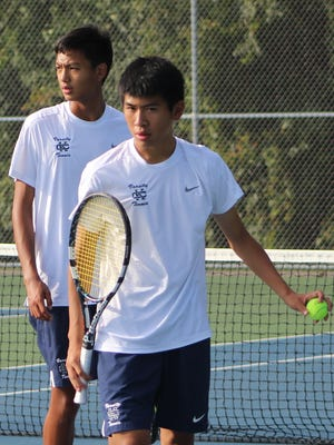 Michael Bian (foreground with ball) and Andrew Du are playing No. 1 doubles for Cranbrook Kingswood this season.