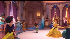 Vanellope (voiced by Sarah Silverman, center) runs
