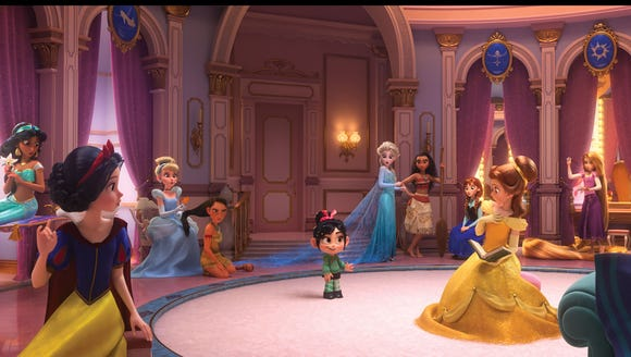 """Vanellope (voiced by Sarah Silverman, center) runs into the Disney princesses in """"Ralph Breaks the Internet,"""" the """"Wreck-It Ralph"""" sequel."""