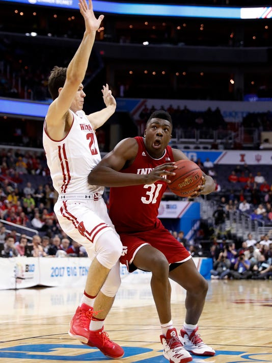 Wisconsin forward Ethan Happ (22) defends against Indiana center Thomas Bryant (31) during the first half of an NCAA college basketball game in the Big Ten tournament, Friday, March 10, 2017, in Washington. (AP Photo/Alex Brandon)