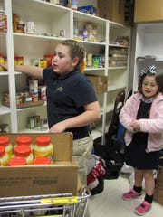 Union County Farm Bureau stocked the shelves at the local food pantry with the help of Ava and Ella Arnett.