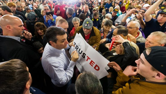 Ted Cruz offers autographs while mingling with supporters