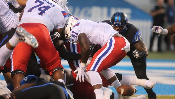 Louisiana Tech's Bobby Holly (41) fumbles the ball