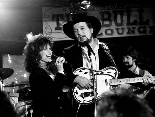 Waylon Jennings and wife Jessi Colter are singing a duet at the packed Buddy Killen's Stockyard on Feb. 9, 1988.
