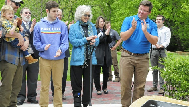 Rudy Jordan, center, celebrates the trail at Point Park being named after her late husband Peter Jordan.