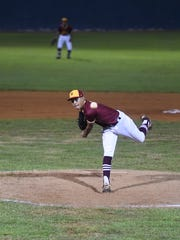 Ethan Lizama pitches for Father Duenas during his Independent Interscholastic Athletic Association of Guam Boys Baseball championship game against the George Washington Geckos at Paseo Stadium on Dec. 23, 2017.
