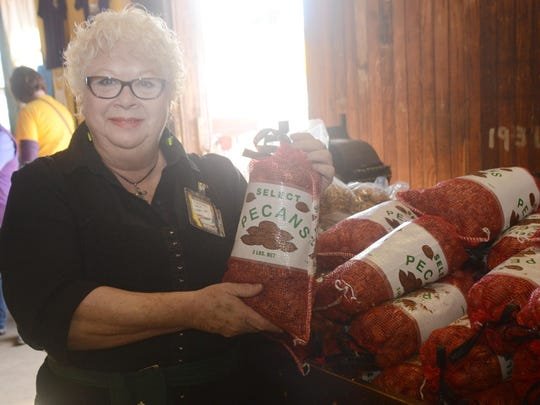 Juli Leavitt, head of the Country Store in Colfax, poses with a bag of pecans during the 2014 Louisiana Pecan Festival.