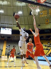 Southern Miss' D'Angelo Richardson shoots for the basket
