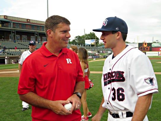 Rutgers University football coach Chris Ash talks to