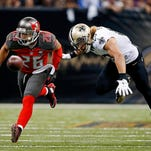 Tampa Bay Buccaneers defensive back Sterling Moore (26) forces a fumble out of the hands of New Orleans Saints wide receiver Willie Snead, right, in the second half of an NFL football game in New Orleans on Sunday.