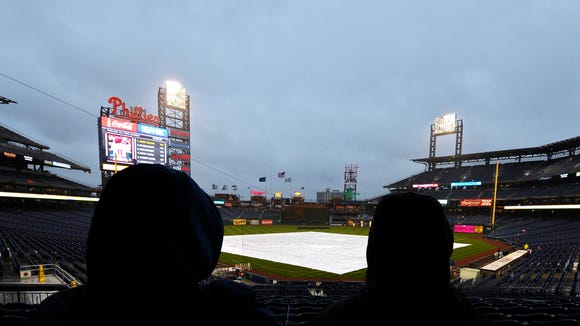 PHILADELPHIA, PA - APRIL 29: Fans wait out a rain delay before the game between the New York Mets and Philadelphia Phillies at Citizens Bank Park on April 29, 2014 in Philadelphia, Pennsylvania. (Photo by Drew Hallowell/Getty Images)