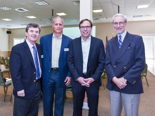 Martin County Community Foundation board members, from left, Brian Foss and Scott Wade with Scott Roads of Spectra Investment Management and Dennis Fruitt at the foundation's Speaker Series featuring Michael Verde.