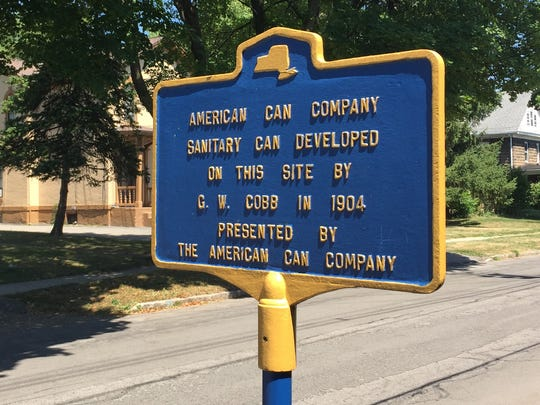A landmark sign outside of the old American Can Company factory on Parce Avenue in Fairport.