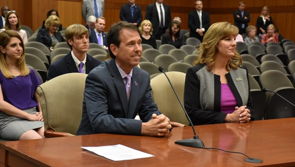 Chris Maggio and wife Jennifer address the University of Louisiana System Board of Supervisors Thursday. Maggio was named the 19th president of Northwestern State University.
