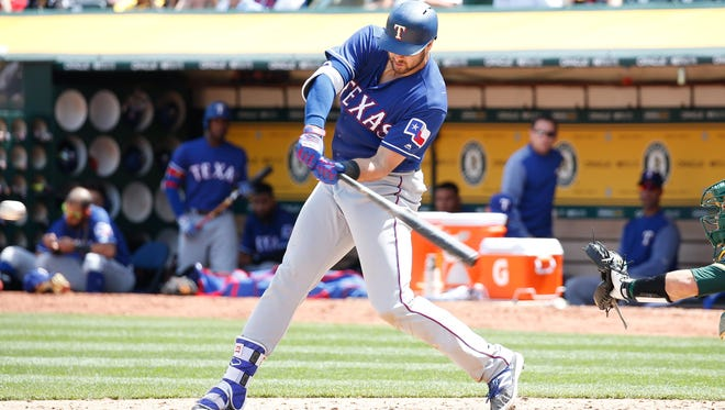 Texas Rangers third baseman Joey Gallo (13) hits a solo home run against the Oakland Athletics during the fifth inning at Oakland Coliseum. M