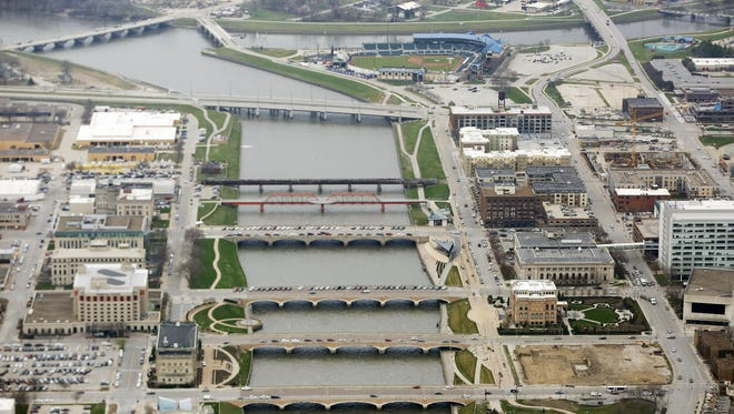 An aerial view of the Des Moines River as it passes by downtown and meets the Raccoon River in Des Moines.
