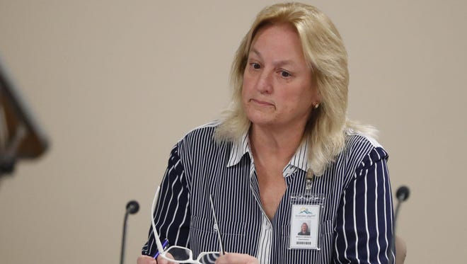 Scottsdale Unified School District Superintendent Denise Birdwell listens during a governing-board meeting Jan. 30, 2018. The board accepted the resignation of former CFO Laura Smith, who resigned after payments to a company she had ties with were reported.