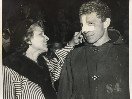 Tommy Trent (right) and Gladys Trent talk at a Dobyns-Bennett High School football game during the 1947-48 season. A new sports bar is coming to Market Square and will be named after Tommy, who played football at Georgia Tech.