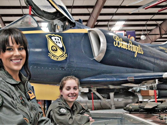 "South Jersey residents Susannah Jane (left) and Brandi Mosko, cast as air-show fighter pilots in the movie ""Wing Girl,"" take part in shooting at the Air Victory Museum in Lumberton."