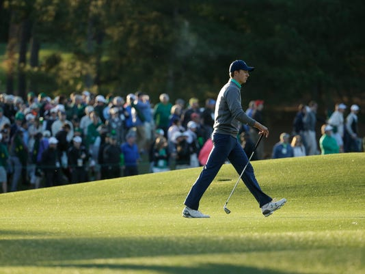 Jordan Spieth walks along the 18th fairway during the third round of the Masters golf tournament Saturday, April 9, 2016, in Augusta, Ga. (AP Photo/Charlie Riedel)