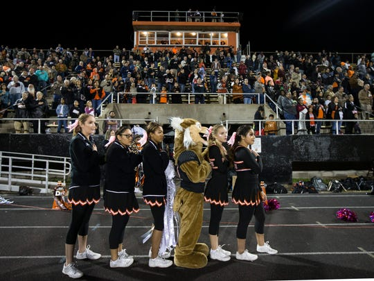 Refugio fans and cheerleaders stand for the national anthem before their game against Kenedy on Friday, Oct. 27, 2017, Bobcat Stadium.