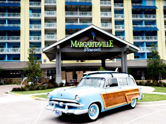 """A 1953 Ford """"Woody"""" Station Wagon is seen parked in front of the entrance during an exclusive sneak peek inside the all-new Margaritaville Resort in Gatlinburg, Tennessee on Wednesday, June 27, 2018. The resort, which features 163 rooms, a pool, spa and bar is scheduled to open on June 28."""